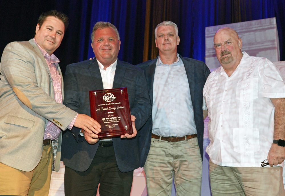 From left: Matthew Ferguson, VSS International, Inc. (VSSI), accepts the 2019 President's Award from ISSA President Rex Eberly, along with VSSI's Jeff Roberts and Jeffrey Reed. Photo by Tom Kuennen, courtesy of FP2.
