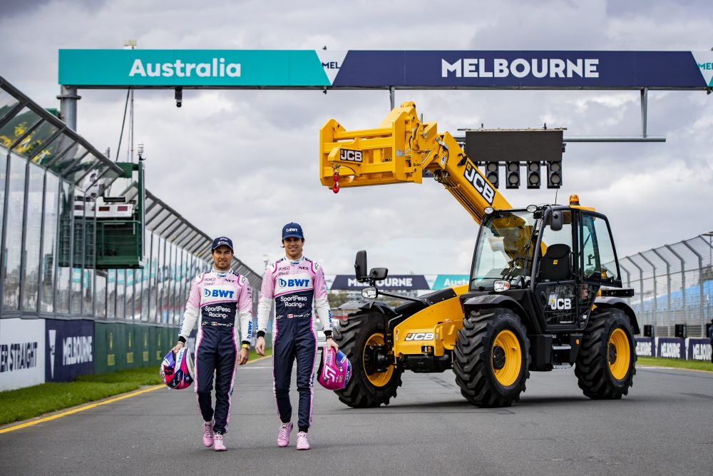 SportPesa Racing Point F1 drivers Sergio Perez (left) and Lance Stroll pictured with a JCB Loadall