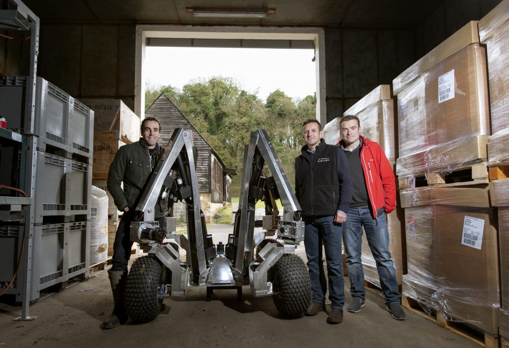 Agricultural Robots are being tested at the Leckford Estate (aka waitrose farm) Pictured with Harry the robot are Sam Watson-Jones, co-founder Small Robot (green jacket) Joe Allnutt, head of Technology SmallRobot (red jacket) and Andrew Hoad, Head of Leckford Estate