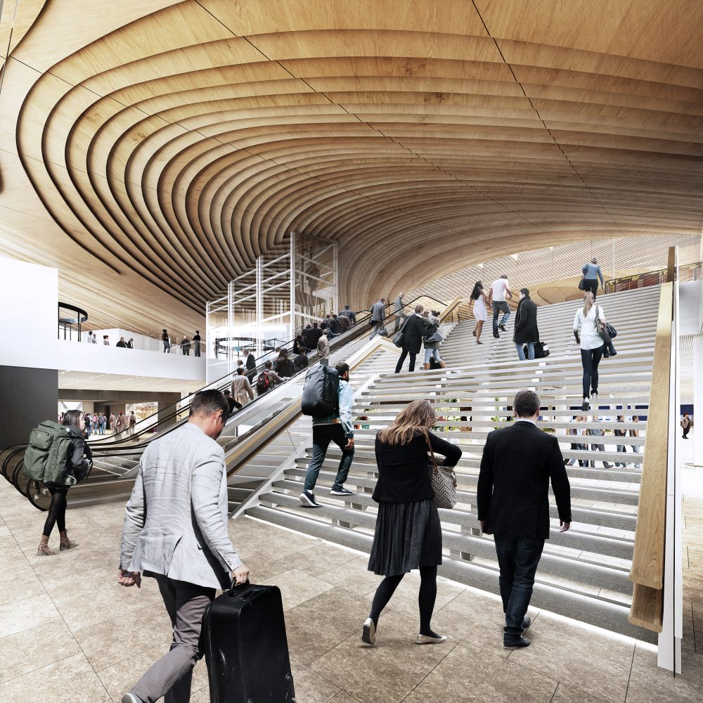 Central staircase from arrivals to departures level. Image by Arkkitehtitoimisto ALA Oy