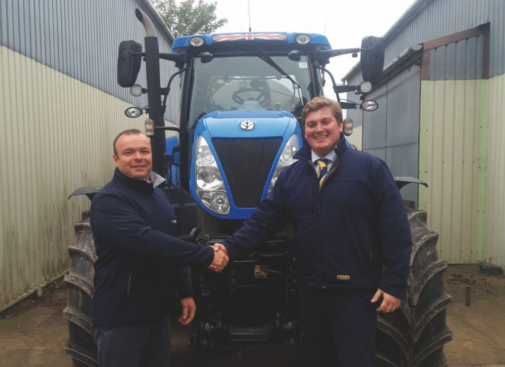 David Evans is welcomed to New Holland by George Mills, New Holland Area Sales Manager.