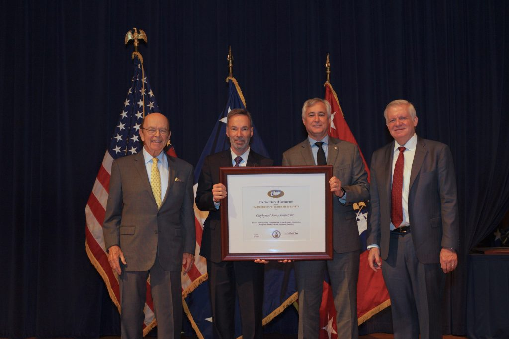 """Christopher Hawekotte, President of Geophysical Survey Systems (GSSI) and Paul Fowler, Vice President Sales and Marketing at GSSI accept the President's """"E"""" Award for Exports at a ceremony Washington, D.C. Pictured in photo from left to right: Wilbur Ross,US Secretary of Commerce, Christopher Hawekotte, President, GSSI, Paul Fowler, Vice President Sales and Marketing, GSSI, Gilbert Kaplan, Under Secretary of Commerce for International Trade"""