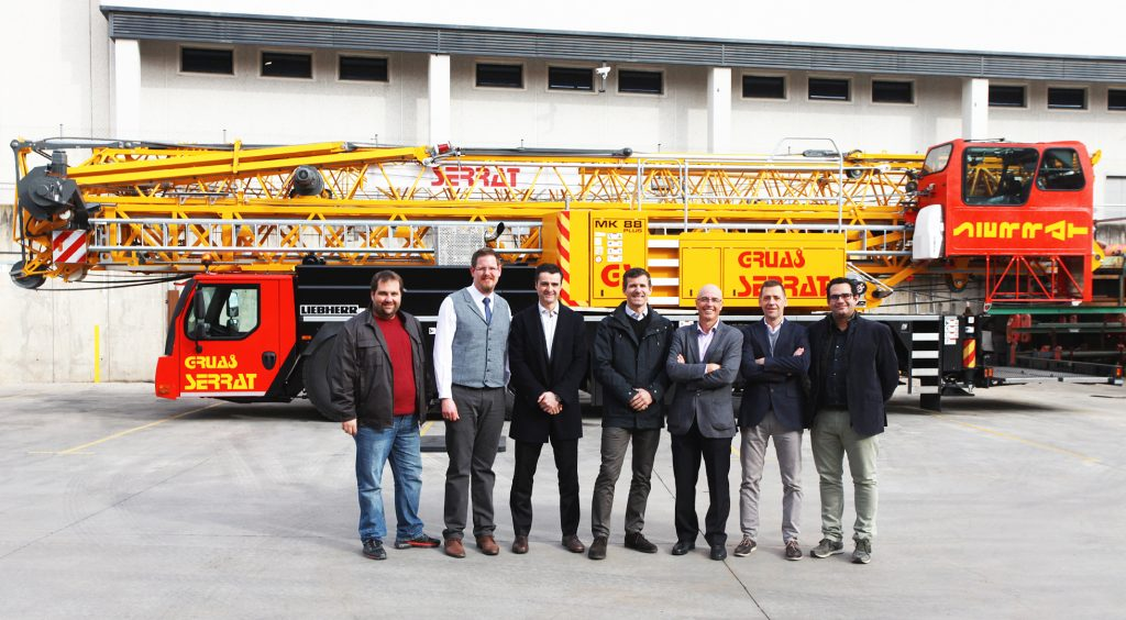 Josep Vega (3rd from right), owner of the Spanish crane company Grùas Serrat, takes delivery of the first MK 88 in Spain. Pictured from left to right: Pedro Invernon (Grúas Cerezo), Daniel Nötzel (Liebherr), Roberto Insausti (Liebherr), Gabriel Iturralde (Liebherr), Josep Vega (Grúas Serrat), Javier Verano (Liebherr), Miguel Cerezo (Grúas Cerezo).