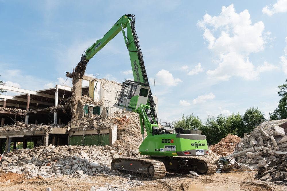 The SENNEBOGEN 830 E demolishing the old furniture store fortress in record time after it stood empty for 10 years