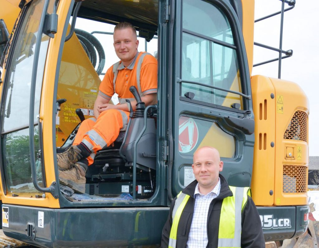 True Plant Hire's operator Jack Asher and MD, Tom Macfarlane with the new Hyundai HX235LCR