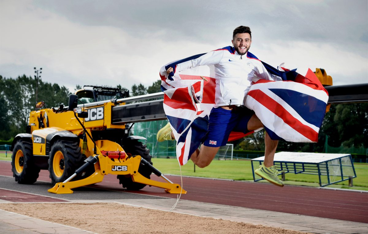 British athlete jumping for joy after landing JCB sponsorship
