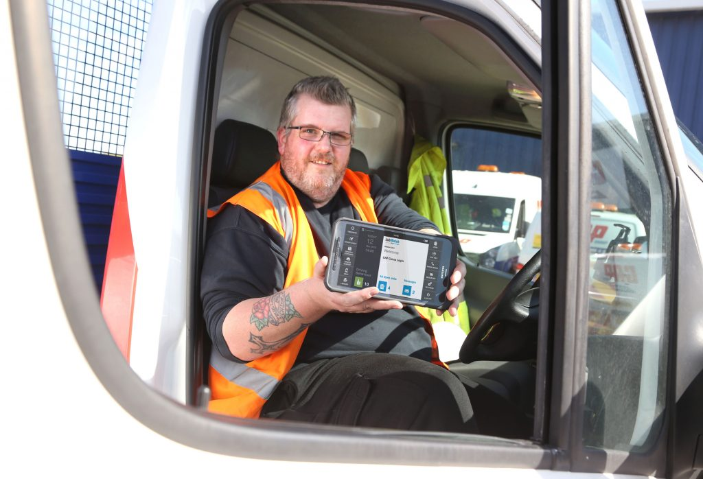 Garry Young, Driver at GAP's Cardiff Lifting depot, with his BigChange tablet device