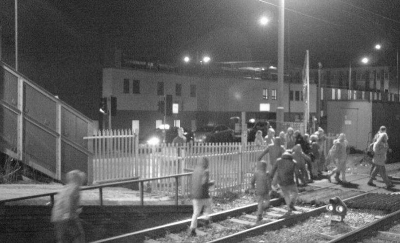 People on the tracks at Grays level crossing in Essex