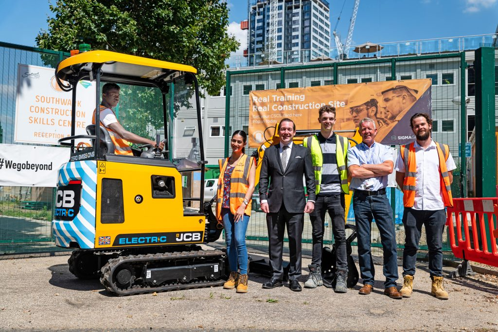 from left to right are Tutor Dean Cox, Operations Director of SCSC John White, Trainee Project Manager Louie Meates , JCB General Manager Charles Stevenson, Degree Apprentice for Construction Management Alexia Mikellides and Highways Apprentice Kevin Benn.