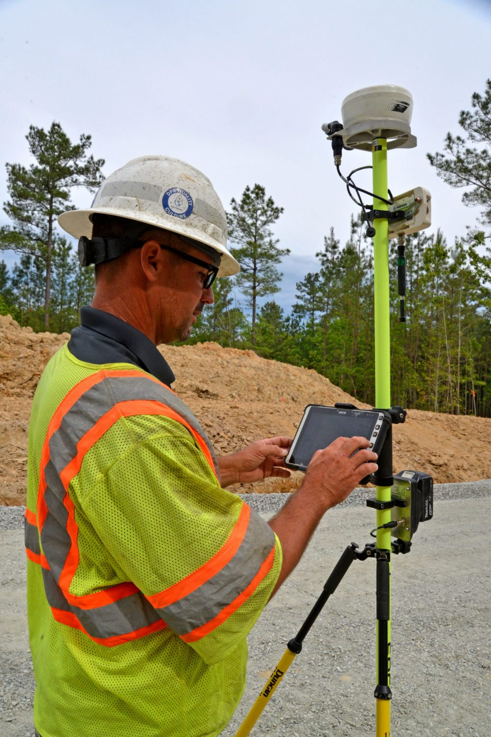 Clay Armstrong confirms data points on the Wirtgen AutoPilot 2.0 portable tablet attached to the Field Rover survey pole.