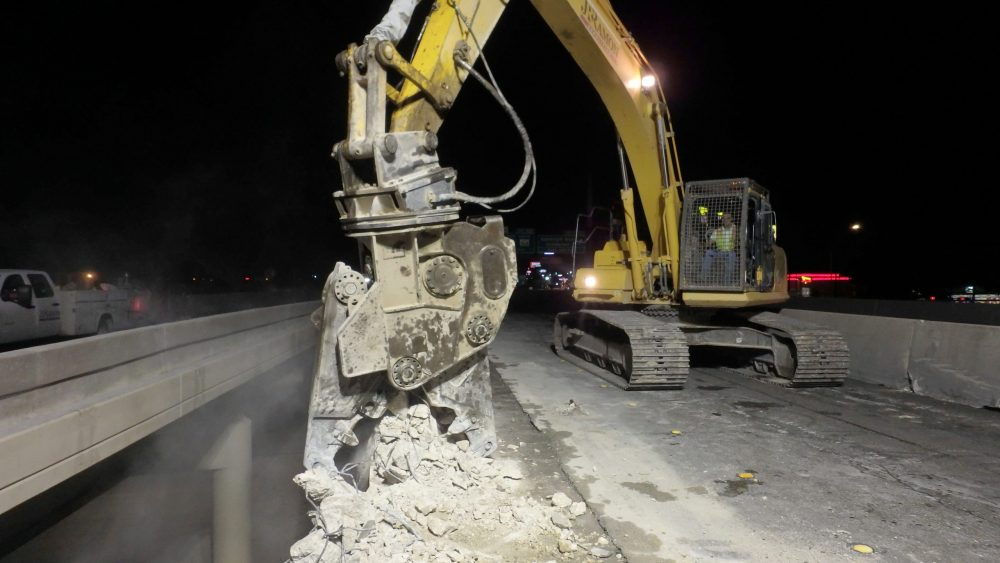 JR RAMON used an 80,000-pound Komatsu PC360 excavator with a CAT pulverizer attachment to demolish the 3-foot-tall, 1-foot-thick, rebar-reinforced concrete rails.