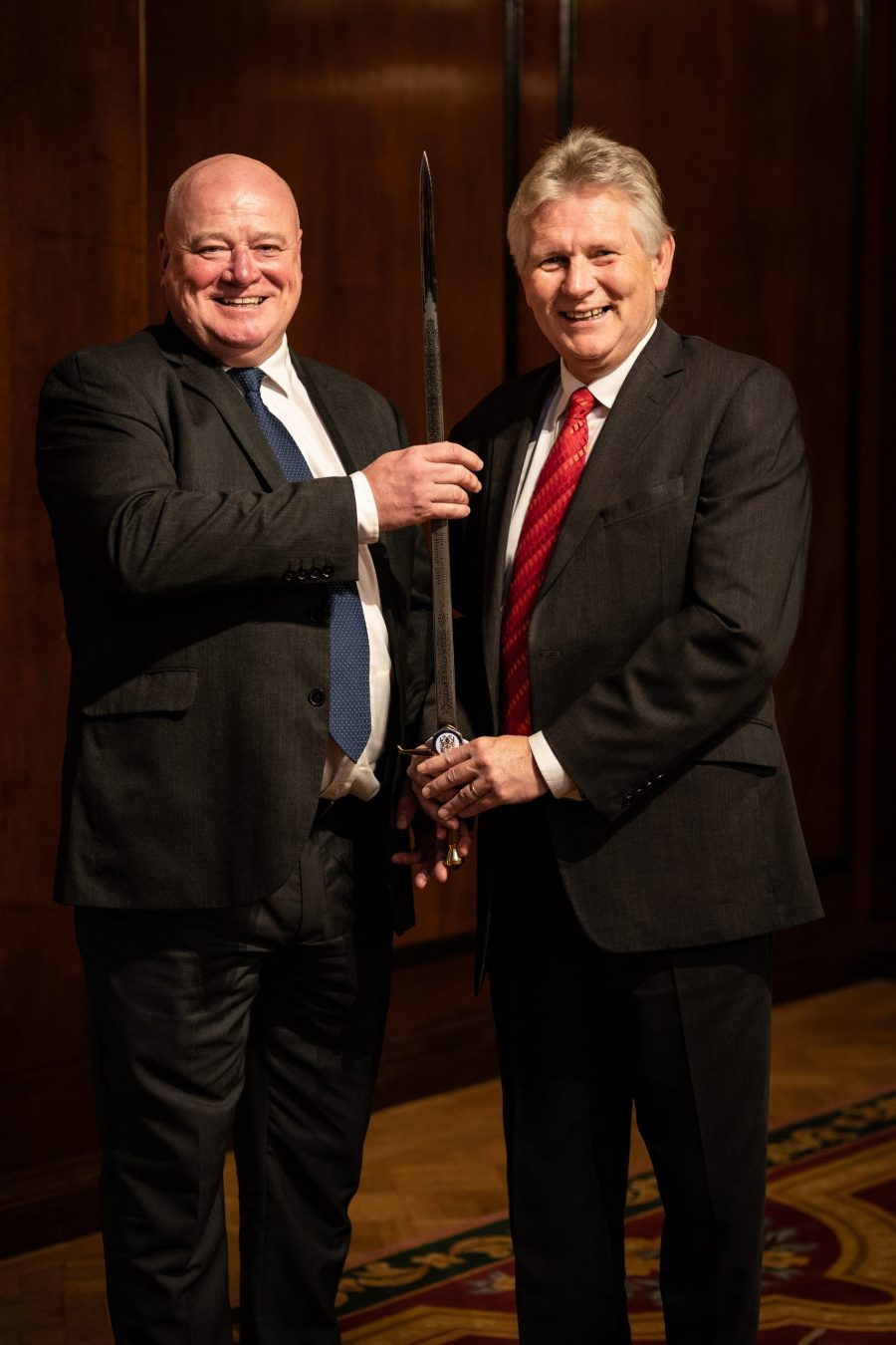 Mike O'Neill receiving the Sword of Honour from Mike Robinson, Chief Executive of the British Safety Council.