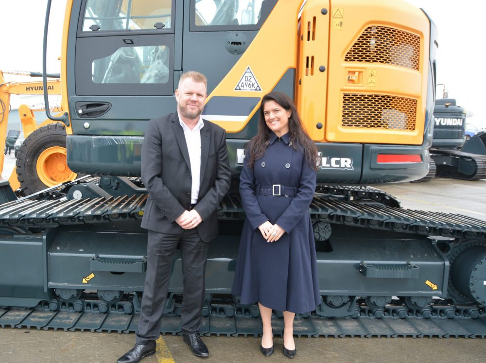 Tony Reeves Hyundai UK and Ireland Sales Manager and Rachel Hamilton Business Development Executive Datatag - with the first machines fitted with Datatag CESAR marking at Tilbury Port, Essex.