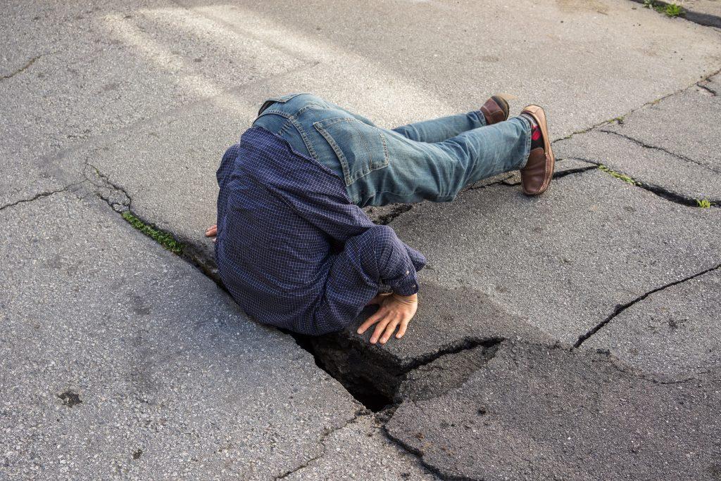 Pothole Photo by Peretz Partensky