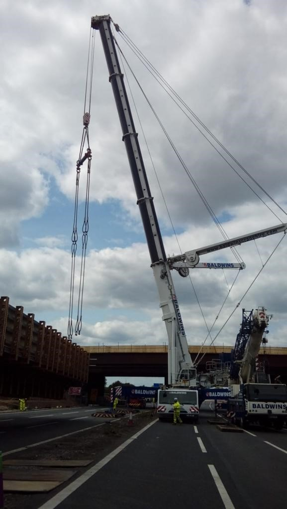 A section of the new Ascot Road bridge being lifted into place over the weekend
