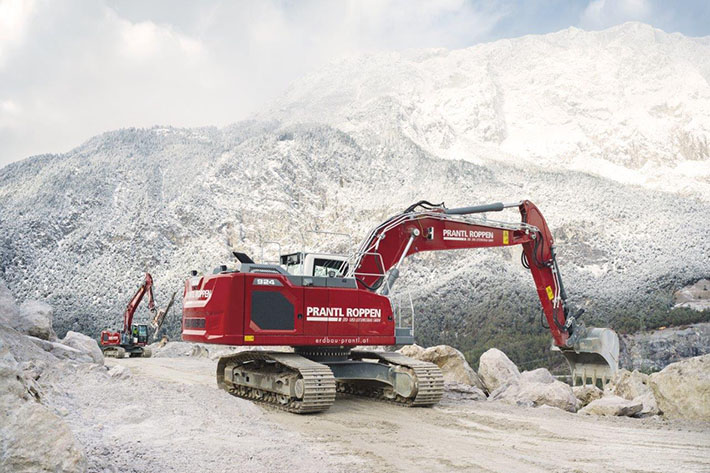 Excavator used in front of an impressive backdrop – Prantl's new ruby-red Liebherr crawler excavator in the Tirol mountains.