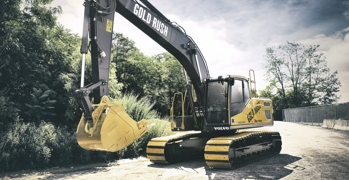 VolvoCE donates $290,000 to two nonprofits from Gold Rush excavator auction