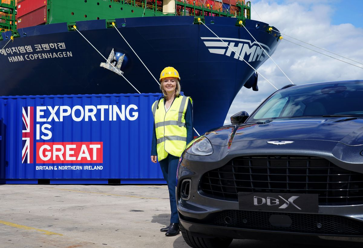 Liz Truss catches a glimpse of the Aston Martin DBX as they get set to sail to the US