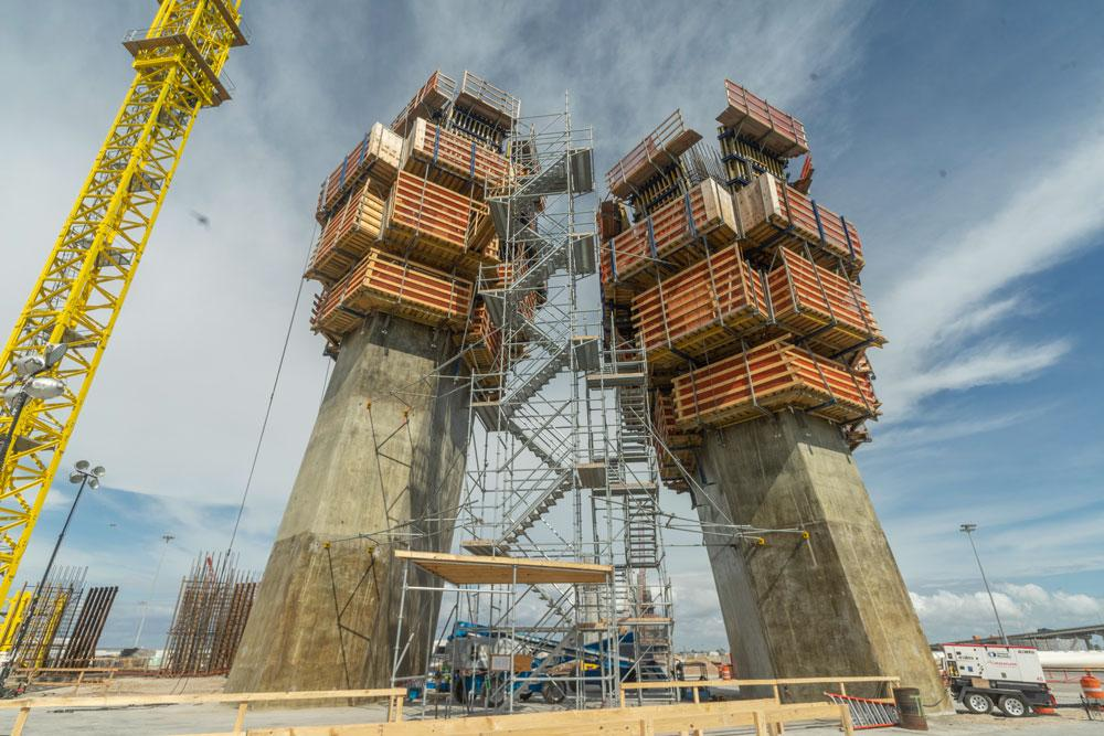 The two pylons are 164 metres high, comprising the A-shaped pylon legs and the pylon tower above. Copyright: Doka