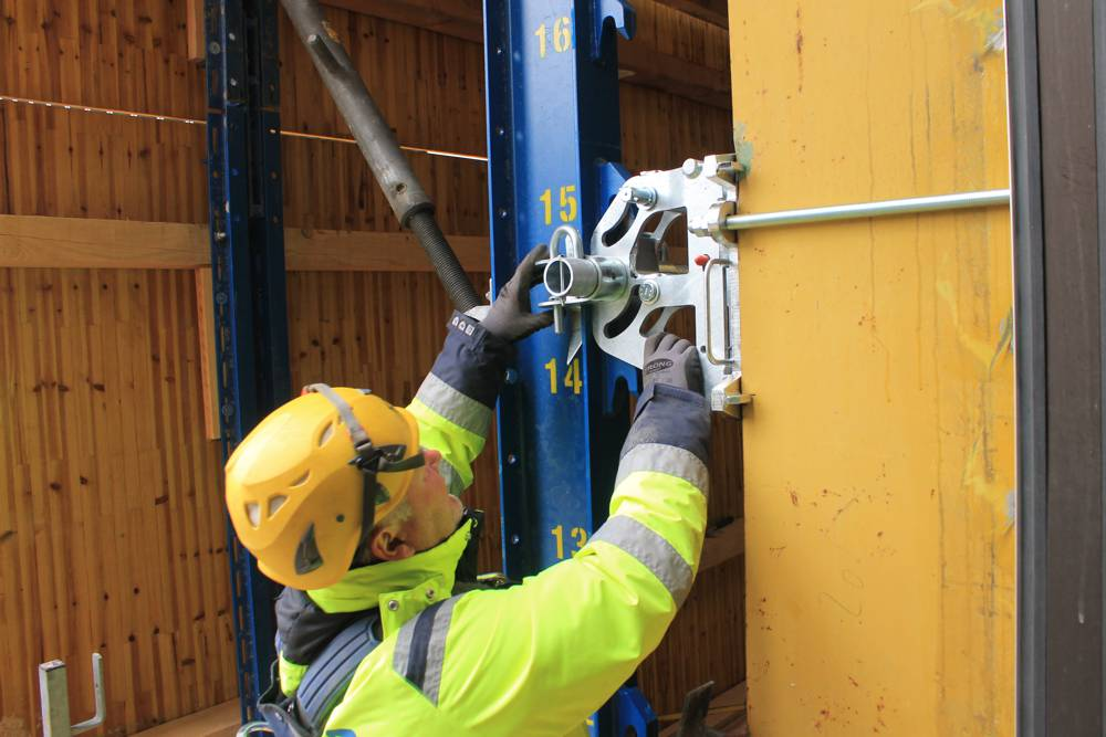 Doka engineers worked closely with the customer to develop project-specific custom suspension points where the protection screens would be affixed to the building. Photo by Doka