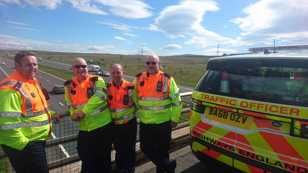 Another day at the office!: pictured at Shap last summer (2019) are Highways England traffic officers Marcus Webster, Paul Morton, Allan Pollard and Tom O'Neill. The traffic officer service was launched in Cumbria in 2006 with the M6 patrolled from outstations at Millness near Kendal and Lowhurst south of Carlisle (Highways England image)