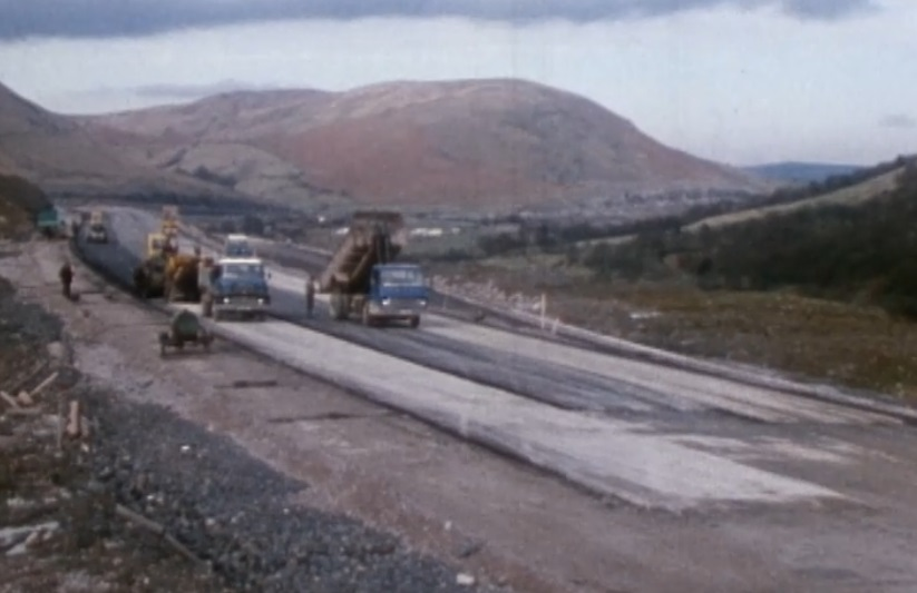After two years of day and night ground works the carriageway starts to take shape. Images from Laing's 30 minute documentary courtesy British Film Institute.