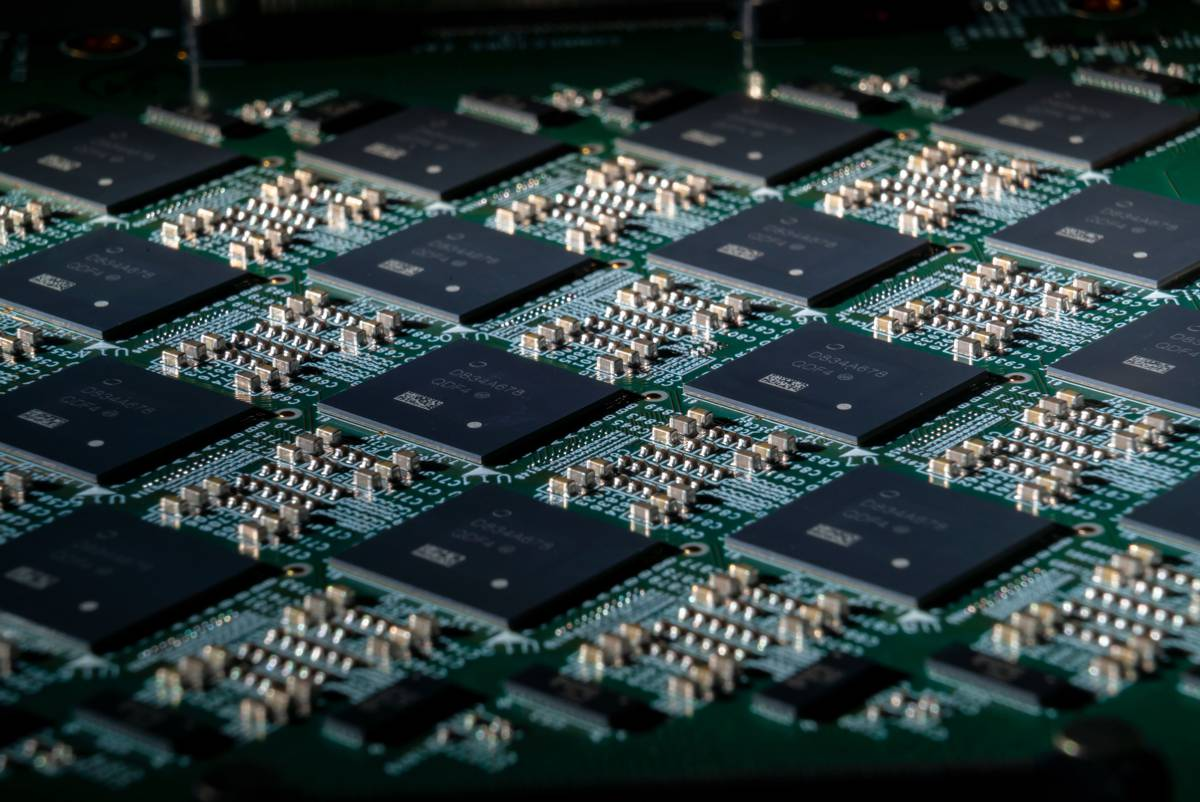 A close-up shot of an Intel Nahuku board, each of which contains 8 to 32 Intel Loihi neuromorphic chips. Intel's latest neuromorphic system, Pohoiki Beach, is made up of multiple Nahuku boards and contains 64 Loihi chips. Pohoiki Beach was introduced in July 2019. (Credit: Tim Herman/Intel Corporation)