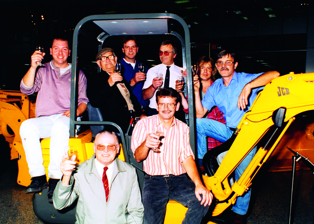The Boot family, including Bill Boot (seated in cab) mark 225 years' service to JCB in 1996