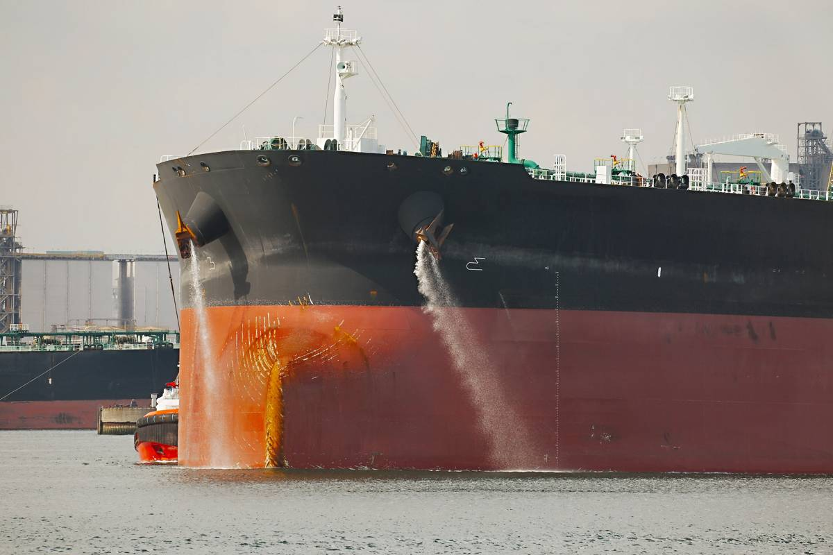 Inhibit corrosion in vessels containing saltwater or brine