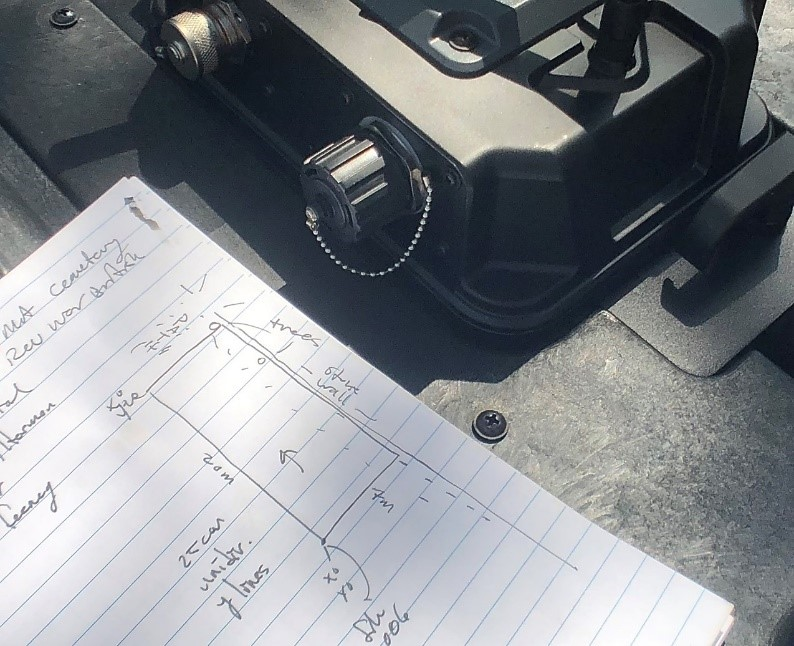 Use a notebook to mark possible targets, obstructions, and possible graves
