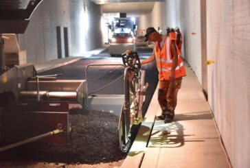 Paving and compacting with low temperature, low emissions asphalt